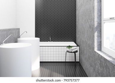 Bathroom interior with black hexagon tile and concrete walls, a large angular tub and a two round sinks. 3d rendering mock up