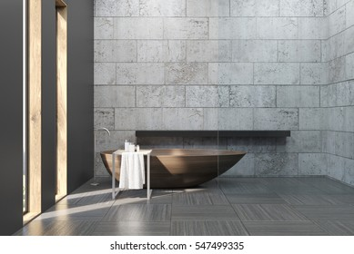 Bathroom interior with concrete walls and floor. There is a large bathtub and a table with self care products and a towel. 3d rendering. Mock up