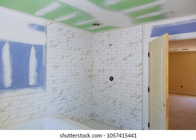 bathroom interior with drywall completely installed