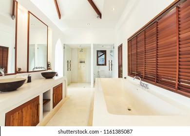 Bathroom interior in luxury villa. White colours