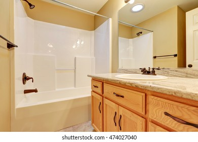 Bathroom interior. Single sink vanity and shower bathtub. Northwest, USA