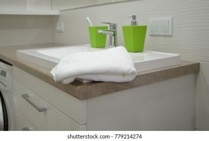 Bathroom interior with sink, faucet and towel