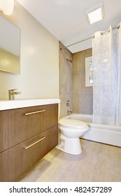Bathroom interior with vanity cabinet and white shower curtain. Northwest, USA