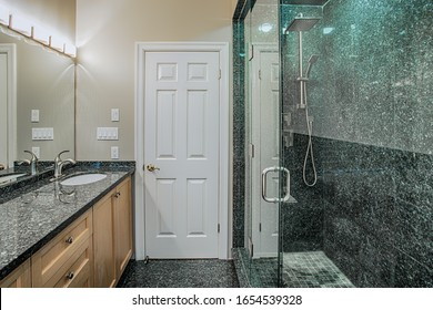 Bathroom interior with walk-in shower and sink vanity. Canada
