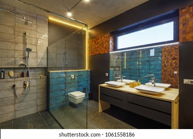 bathroom interior with a washstand; toilet bowl; bath and shower.