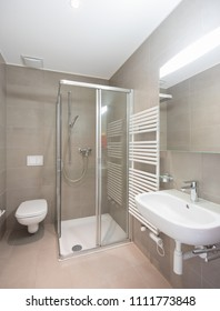 Bathroom with large modern tiles. Nobody inside