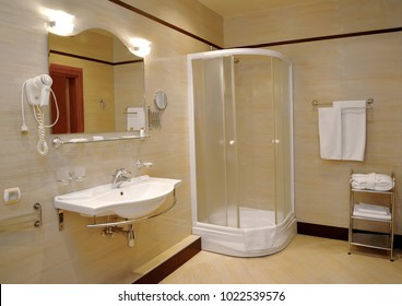 Bathroom in light tones with a shower booth