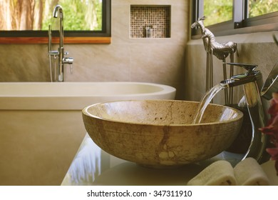 Bathroom Luxury interior decor. Water flow from tap