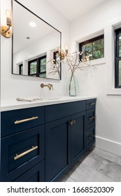 Bathroom in new luxury home with beautiful cabinets and tile floor