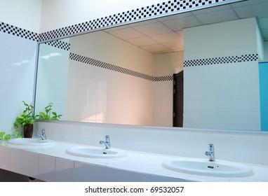 Bathroom at office.Handbasin and mirror in toilet