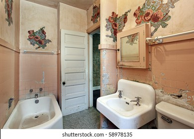 Bathroom with peeling paint in old abandoned home