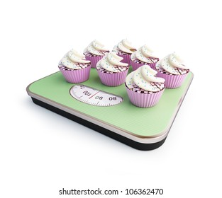 bathroom scale with the cupcakes on a white background