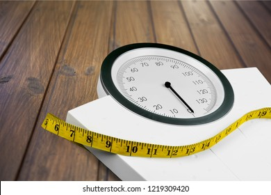 Bathroom scale with a measuring tape on