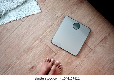 bathroom scale seen in first person man about to weigh himself