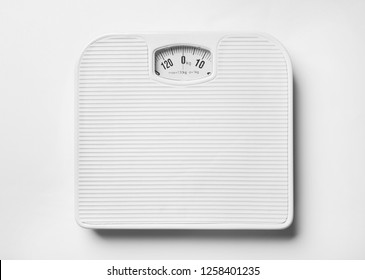 Bathroom scales on white background, top view. Weight loss concept