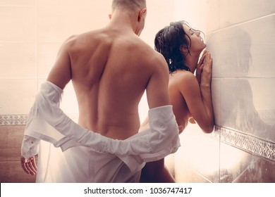 Bathroom. Sex. Passionate couple kissing, boy and girl. Having sex. Young lovers. People in love. Positions kamasutra. Erotic moments. Concept photo. Secret. Fashion. Hot babe. Party. Night background