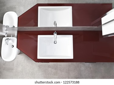 Bathroom sink, bidet and mirror reflection from above