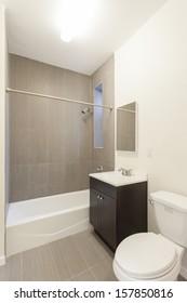 A bathroom in a studio apartment.