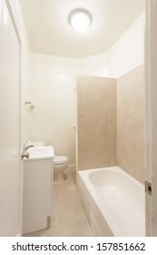 A bathroom in a studio apartment