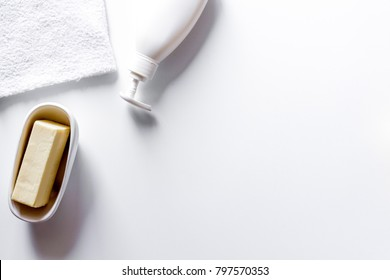 bathroom stuff for hand care and cleaning, soap, cream, aroma oil and apples, bathroom interior table on white background flat lay