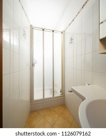 Bathroom with tiles, traditional. Nobody inside