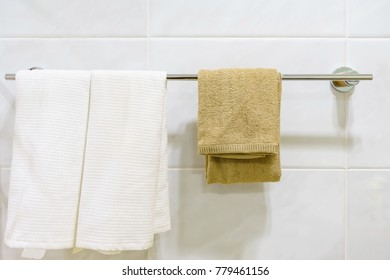 Bathroom Towel - Clean white towel on a hanger prepared to use