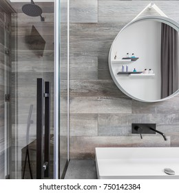 Bathroom with walk in shower, countertop basin and wood effect tiles