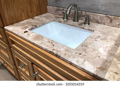 bathroom wooden luxury vanity cabinets with granite countertop, white sink and chrome faucet