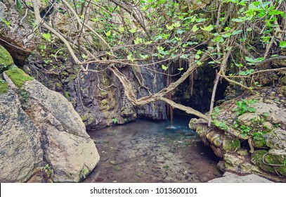 Baths of Aphrodite Grotto with pond and water spring
