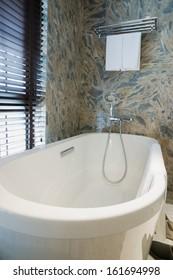 the bathtub in a bathroom
