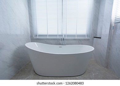 Bathtub in a bathroom close up