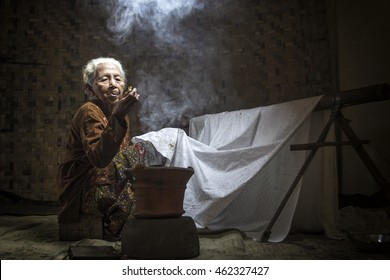 Batik Maker, A Skillful Old Woman making a pattern on Batik Cloth. Date taken 01 December 2012.