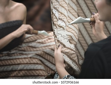 Batik making and painting tradition in Cirebon. Batik Indonesia pattern, symbol and clothing has become a world heritage by UNESCO in 2009.