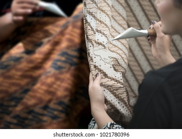 Batik painting and waxing traditional making process with hand dyed. Indonesia batik pattern, symbol, clothing and fabric has become a world heritage by UNESCO in 2009.