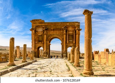 BATNA, ALGERIA - MARCH 3, 2018: Trajan's Arch of Timgad, a Roman-Berber city in the Aures Mountains of Algeria. UNESCO World Heritage Site