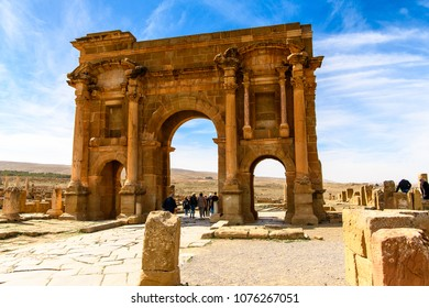 BATNA, ALGERIA - MARCH 3, 2018: Trajan's Arch of Timgad, a Roman-Berber city in the Aures Mountains of Algeria. UNESCO World Heritage Site