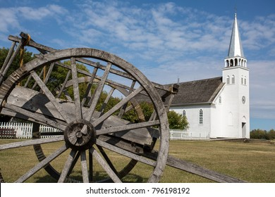 Batoche - National Historic Site - located in Saskatchewan, Canada. A red river cart in the foreground was the primary means of transportation in the late 1890s. Historic Battle of Batoche.