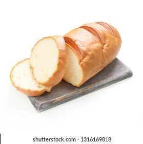 Baton on the board. White loaf. Cut loaf into pieces on a white background
