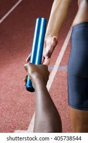 Baton passing between relay runners