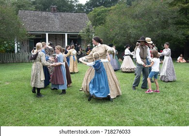 Baton Rouge, Louisiana, USA - 2016: Actors dancing at LSU Rural Life Museum, an outdoor museum of Louisiana history.