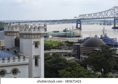Baton Rouge, Louisiana waterfront with Old State Capitol in foreground and Planetarium and I-10 bridge
