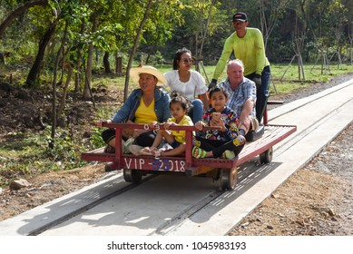 Battambang, Cambodia -14 January 2018: tourists on the Bamboo train at Battambang on Cambodia