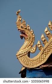 Battambang Cambodia, golden dragon roof carving at Wat Kandal