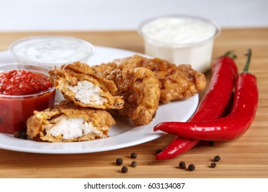 Battered chicken with spicy sauce