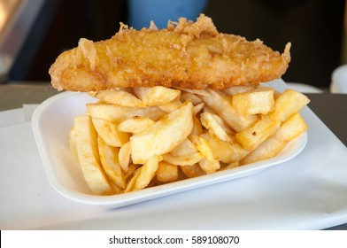 Battered cod and chips in chip shop, England, UK
