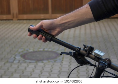 Battered grip is being withdrawn from the handlebar