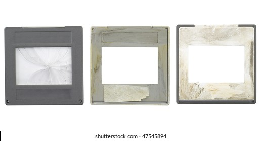 battered grungy 35mm slides, grungy and dirty,one cover slip broken, isolated on white background,free space for your pics