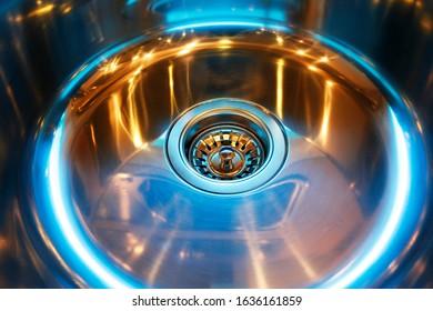 Battered light stainless steel dishwasher
