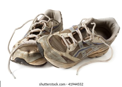 Battered old sneakers, isolated on white.  These have definitely seen better days!