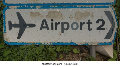 """Battered Road Sign for the """"Airport"""" at Newquay in Rural Cornwall, England, UK"""